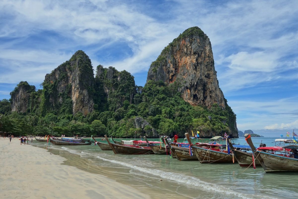 Boats perched on the shoreline of Railay Beach, Thailand