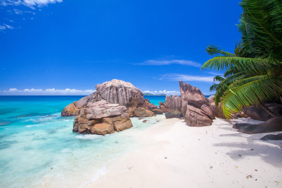 rock formation with white sand beach in Seychelles