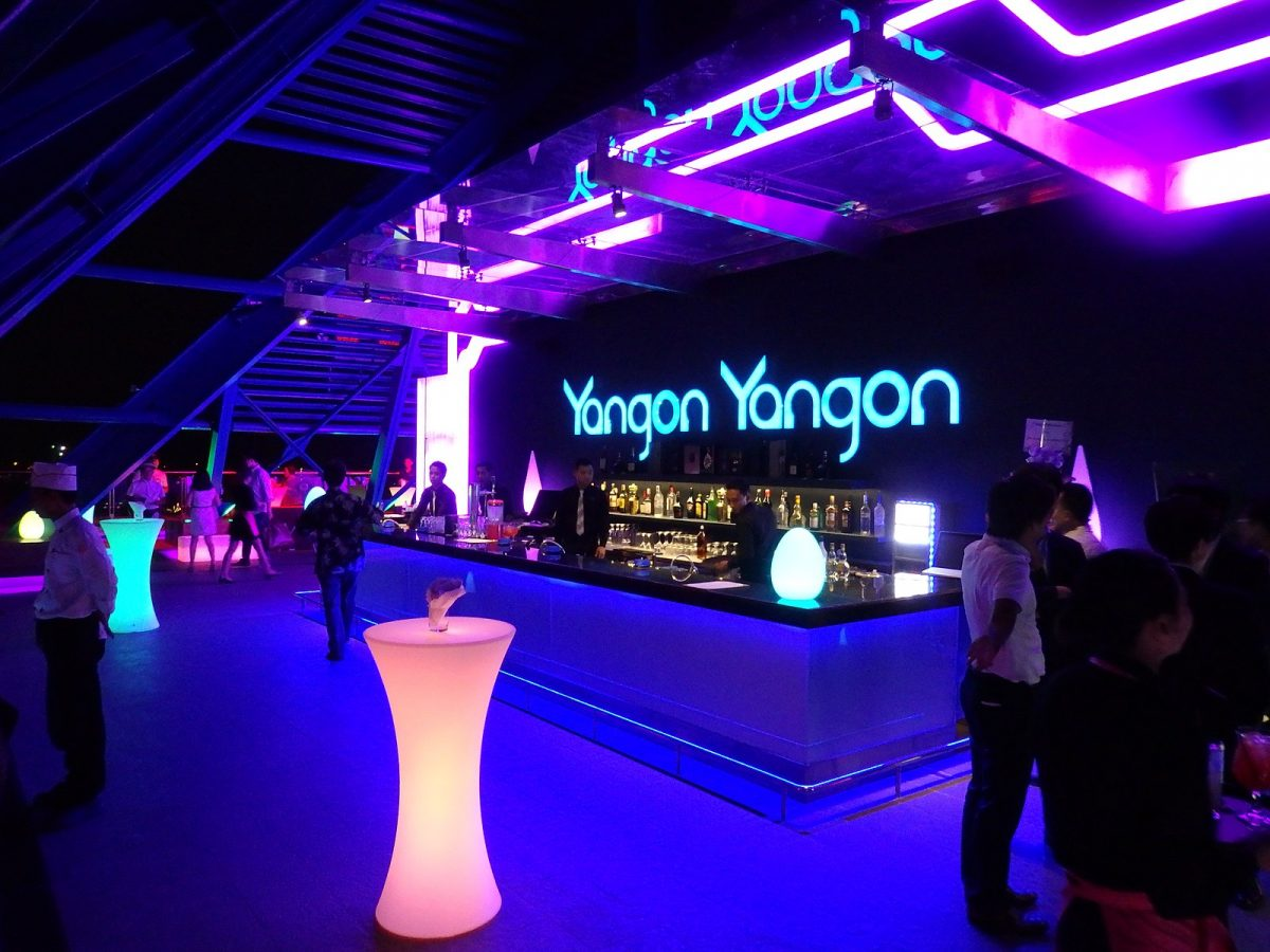 a nightclub at Yangon with neon lights and illuminated tables