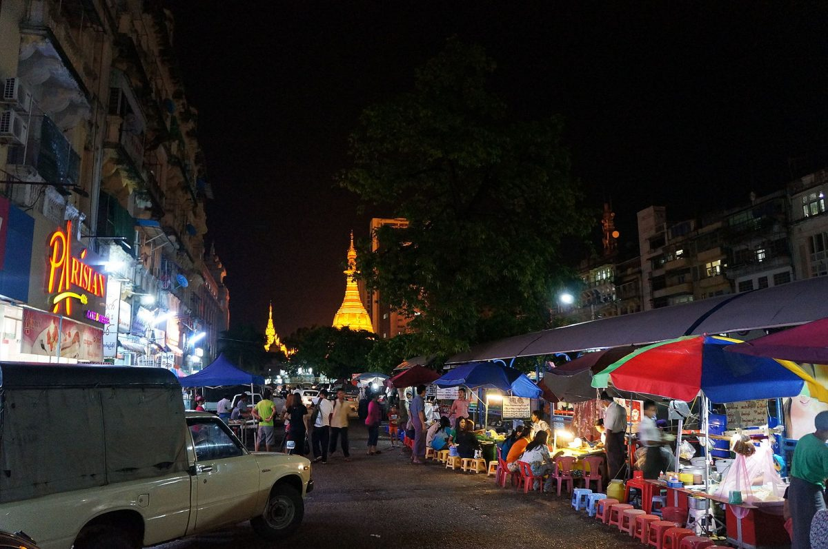 Street food stalls line up in Yangon at night