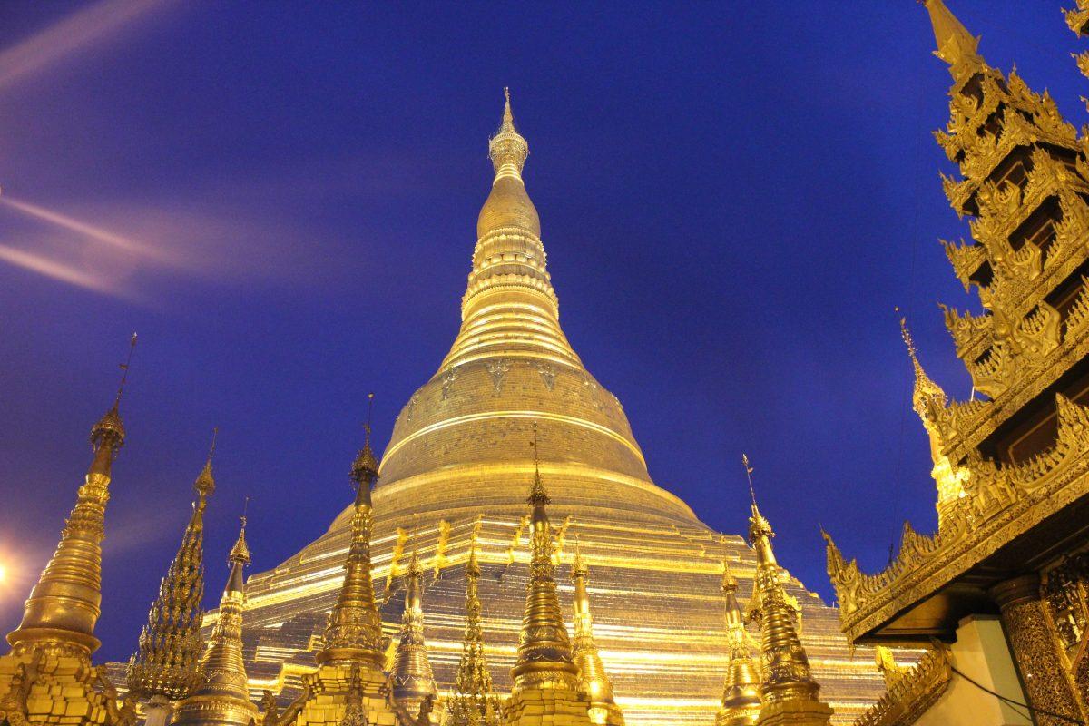 the Shwedagon Pagoda glistening at night