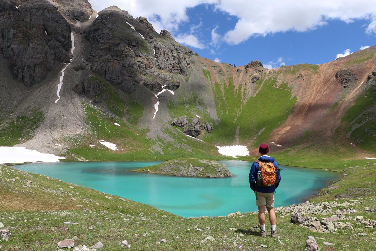 a man standing in front of Island Lake in Colorado