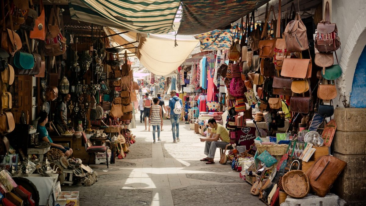 Souk market in Marrakech with items hanging at the sides