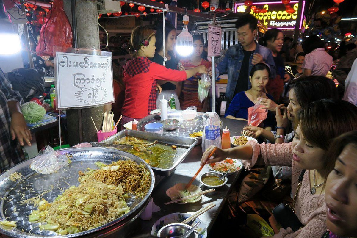 people busy ordering and eating street food at Yangon Chinatown