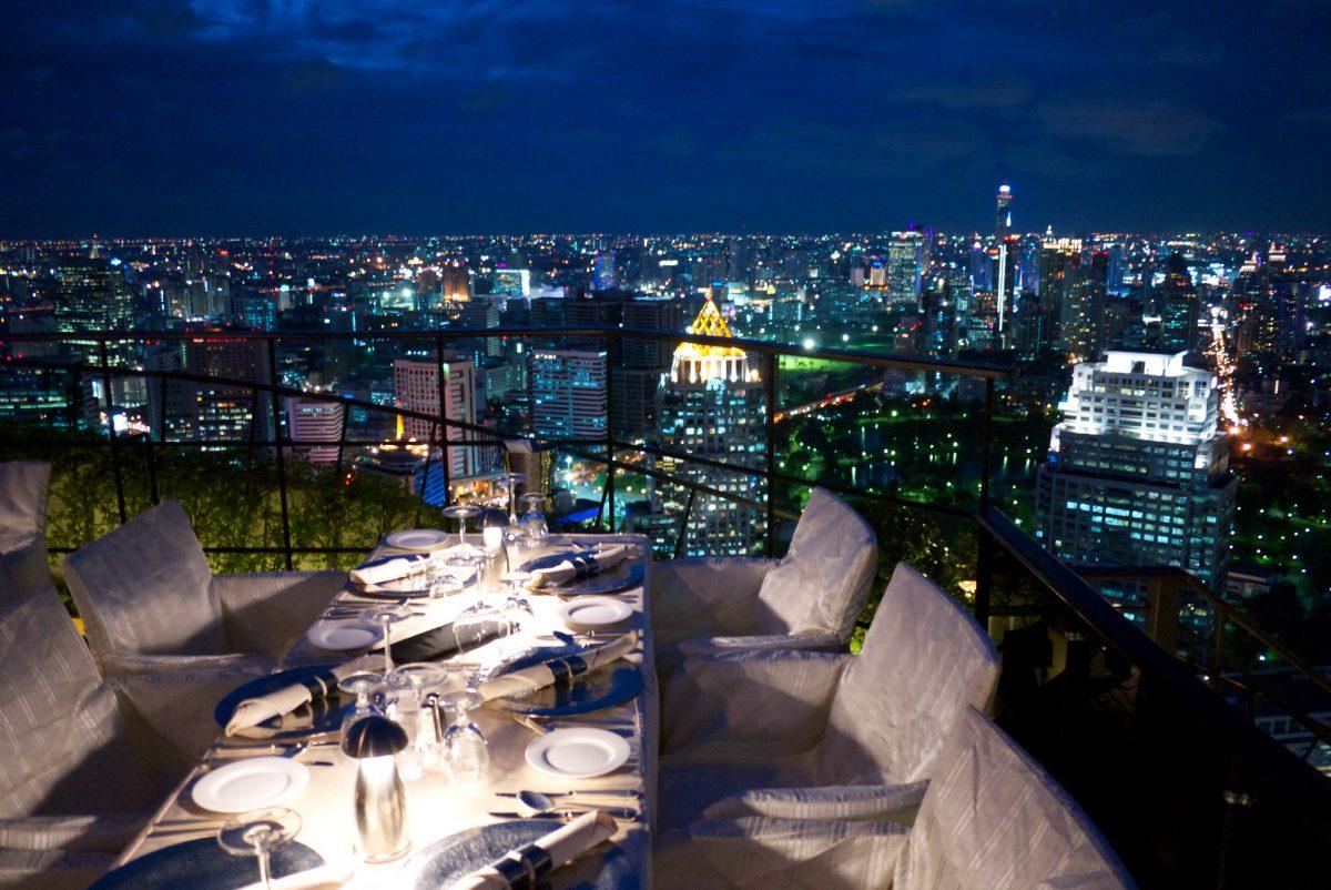 Dinner table at Vertigo with Bangkok skyline in background