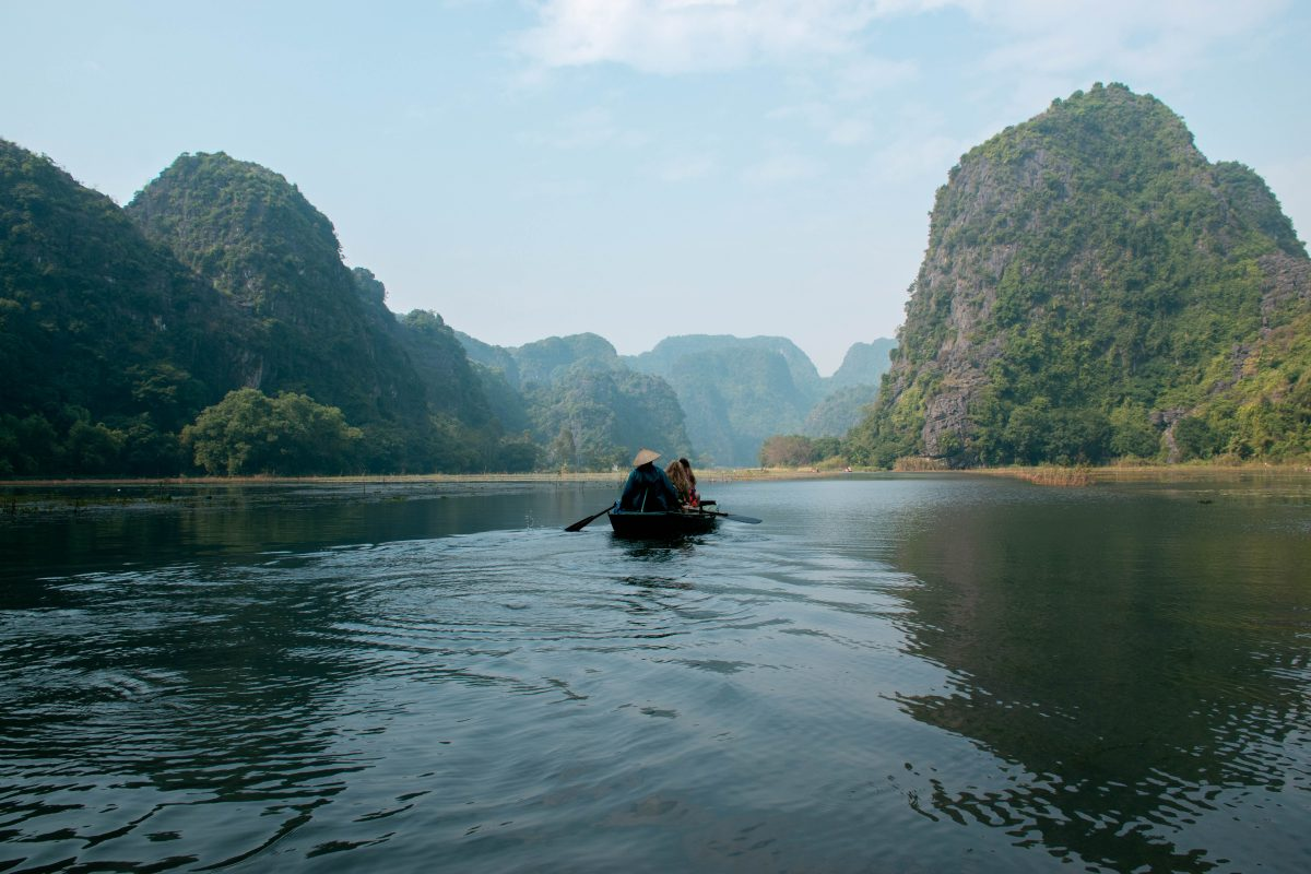 Traditional boat riding on the flowing river of Ninh Binh