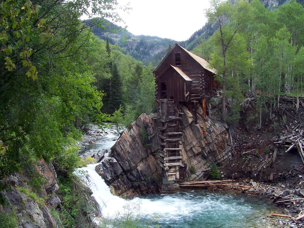 An old wooden house near the waterfall in Crystal Mill
