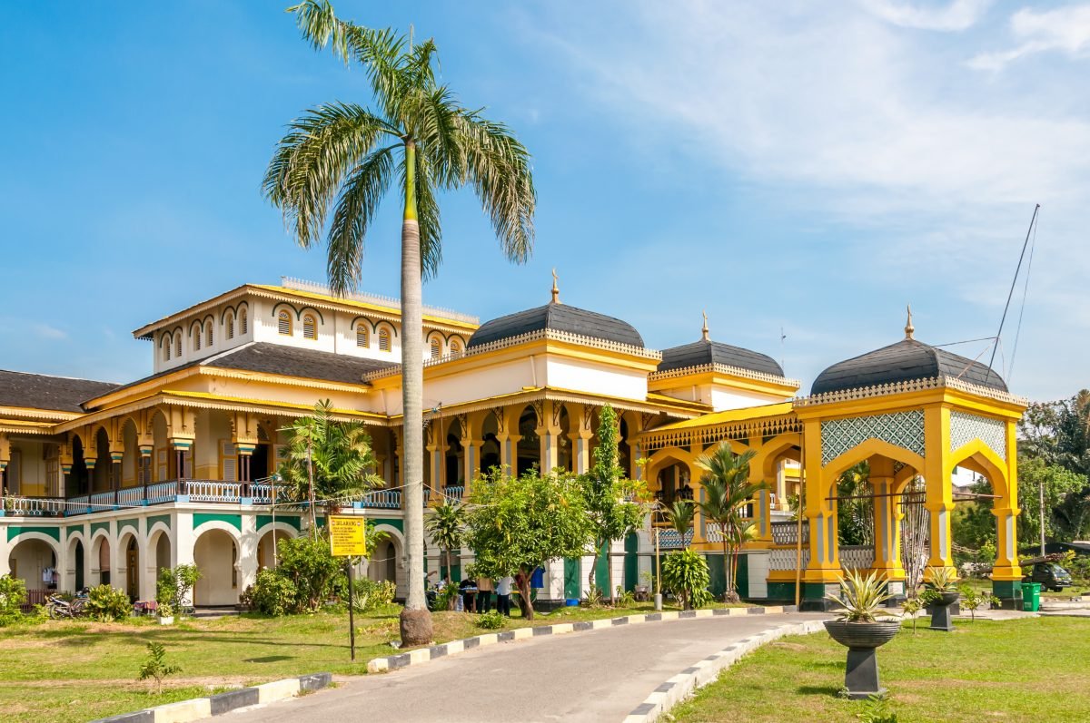 the yellow and white themed Sultan's Palace Maimoon in Medan