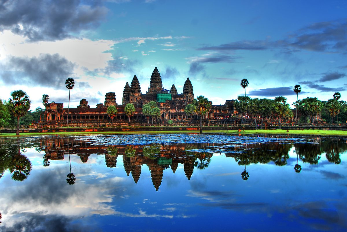 Blue skies reflect on the water in Angkor Wat, Siem Reap, Cambodia