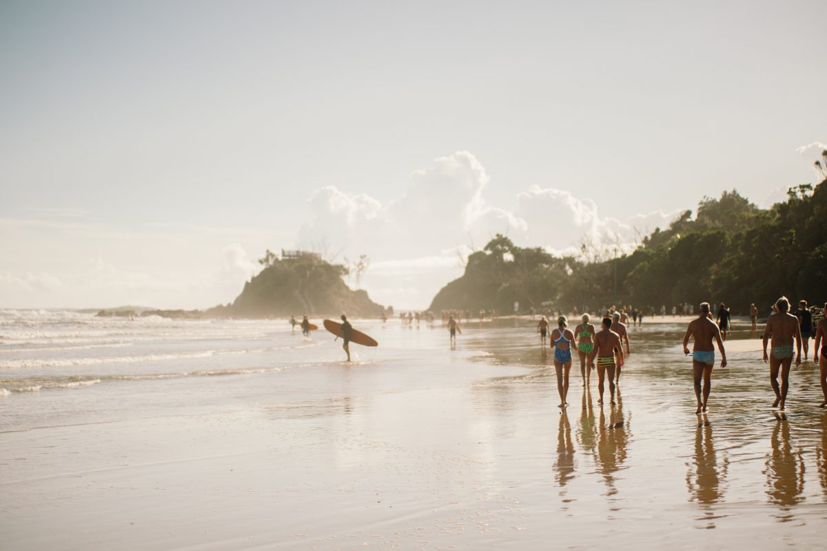 surfers getting ready to surf at Byron Bay australia during summer time