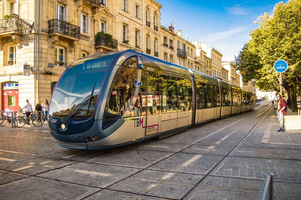 a local TBM tram traverse the streets of Nantes