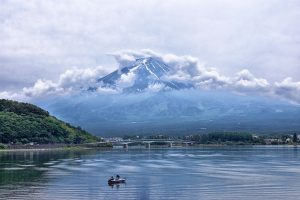 A scenic view of Mt. Fuji overlooking Lake Ashi