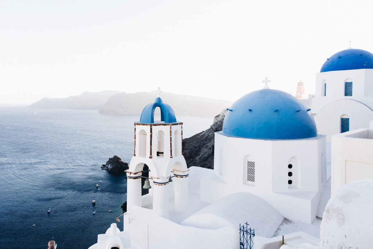 beautiful contrast of the blue and white painted structures in Santorini