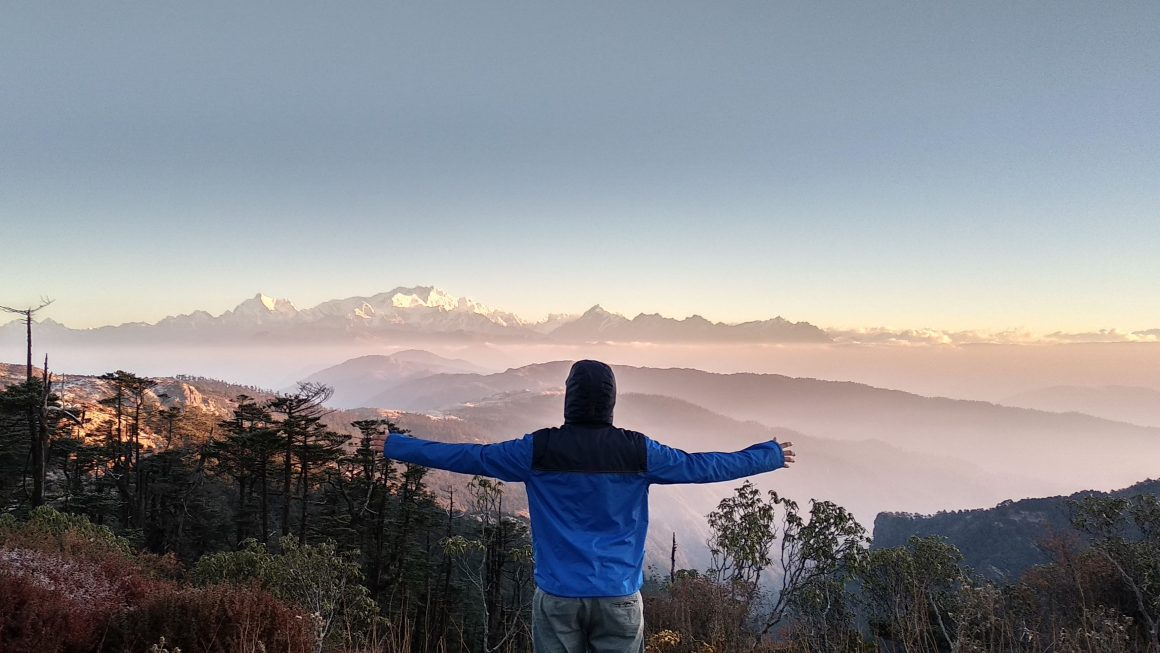 A man standing on mountain during daytime