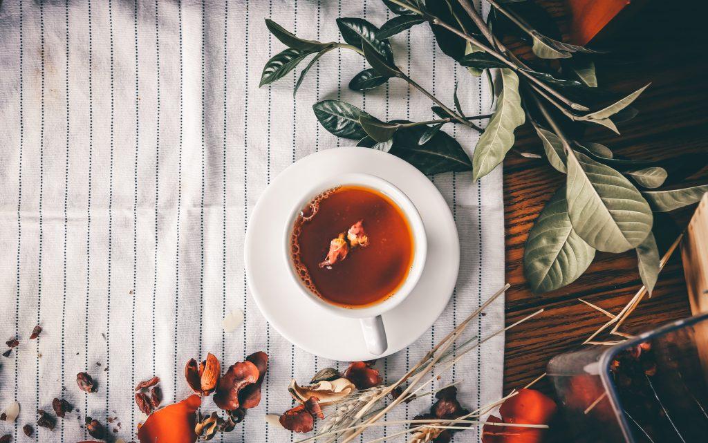 A cup of Darjeeling tea on a table cloth