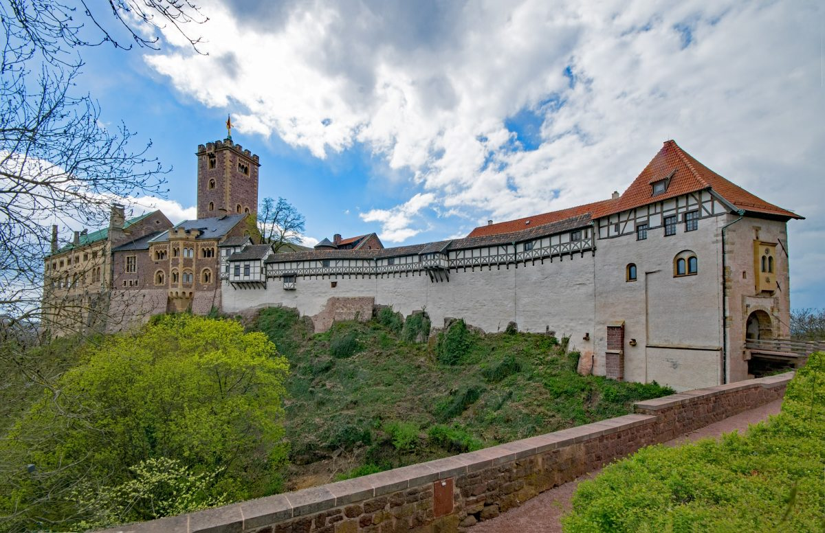 Originally built in the Middle Ages, Wartburg Castle sits on a precipice of 410 m (1,350 ft) overlooking the town of Eisenach.