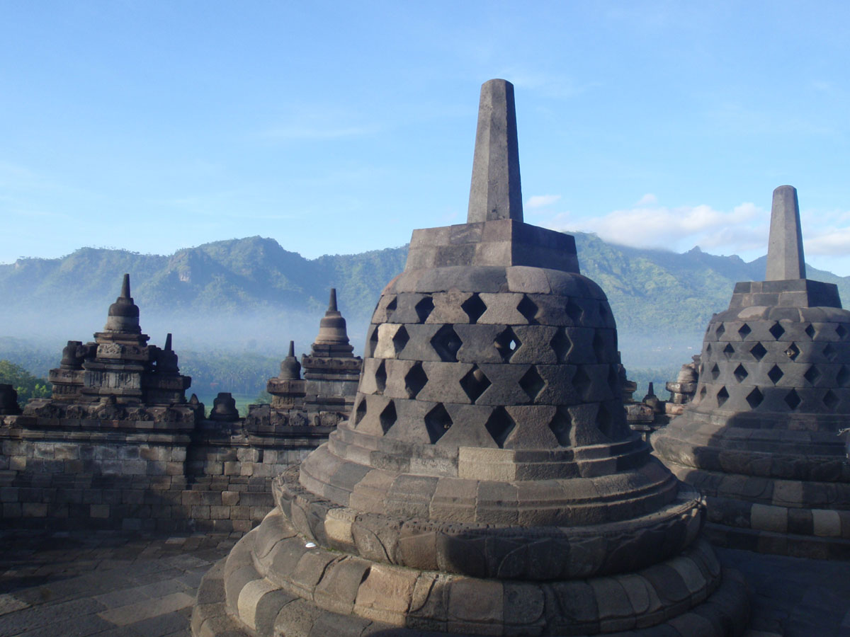 Borobudur temple in Yogyakarta Indonesia with the mountains at the brackground
