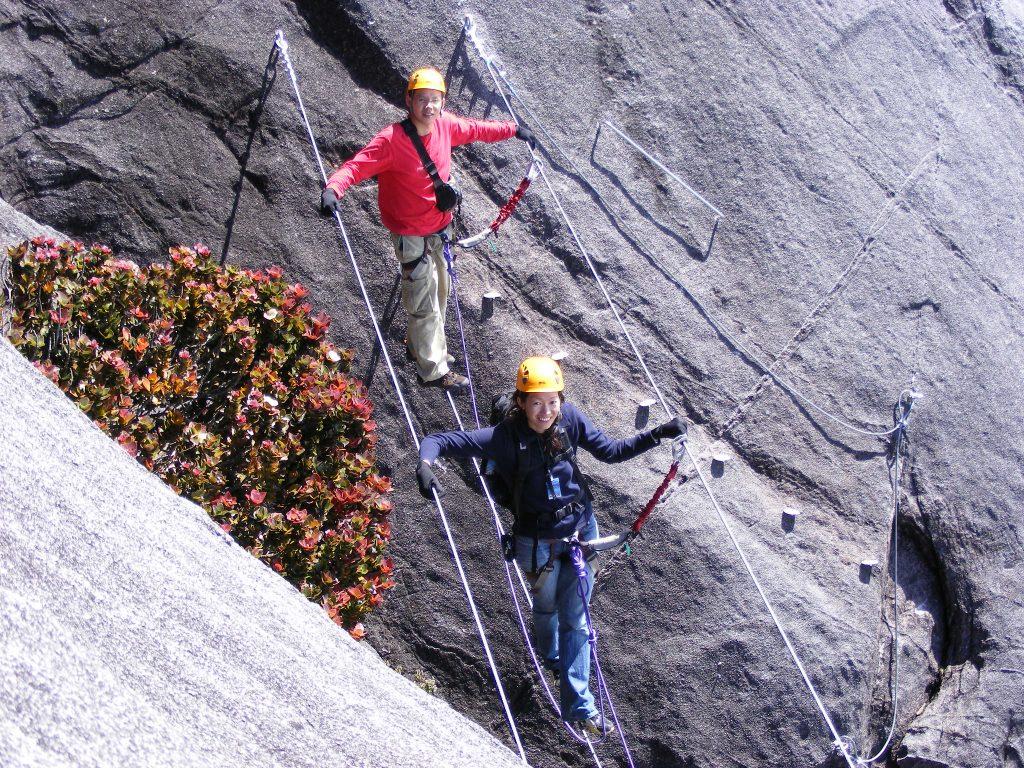 Hikers going down the Mountain Kinabalu via the Ferrata, Low's Peak Circuit