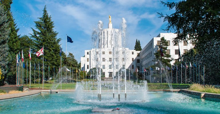 A fountain with the Oregon Capitol Building in the background.