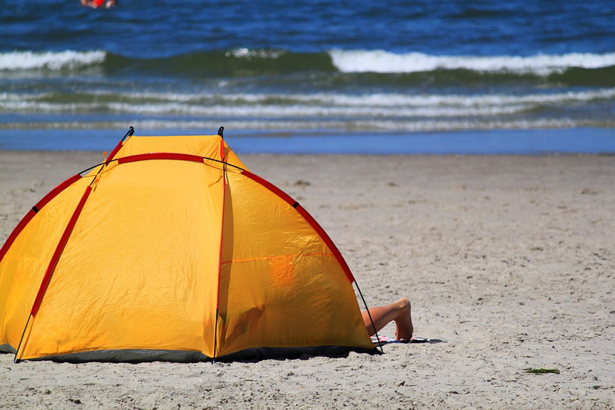 Orange beach tent on the sandy beach
