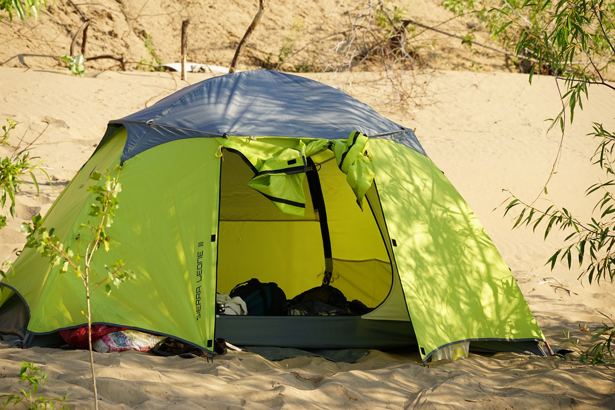 a beach tent with privacy zip lining