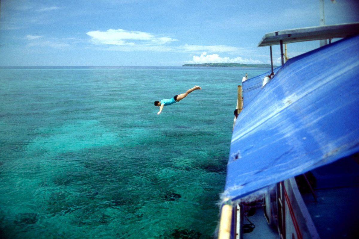 man diving for marine life in wakatobi island indonesia