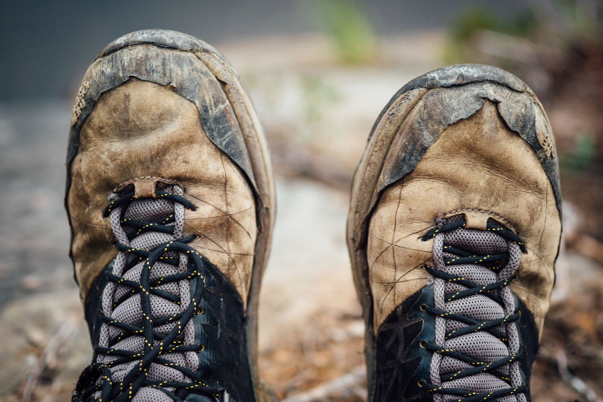 Dirty and used hiking boots