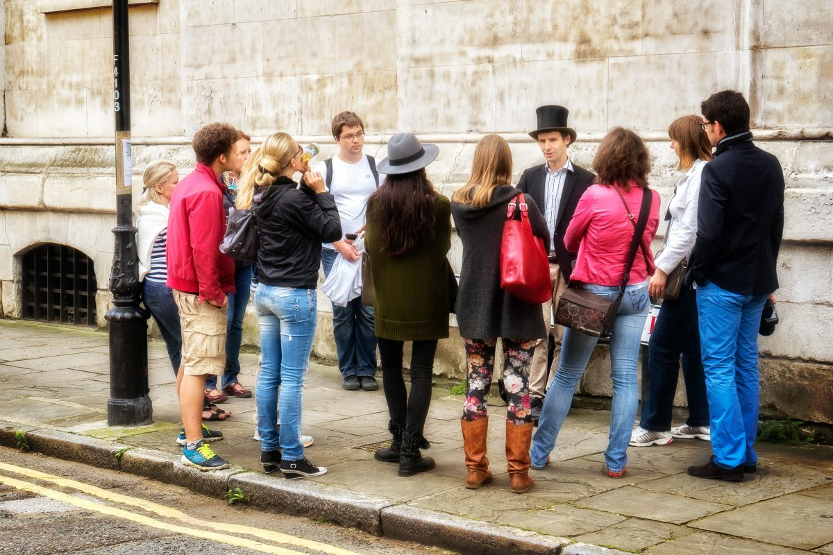 A top-hatted tour guide in London, UK