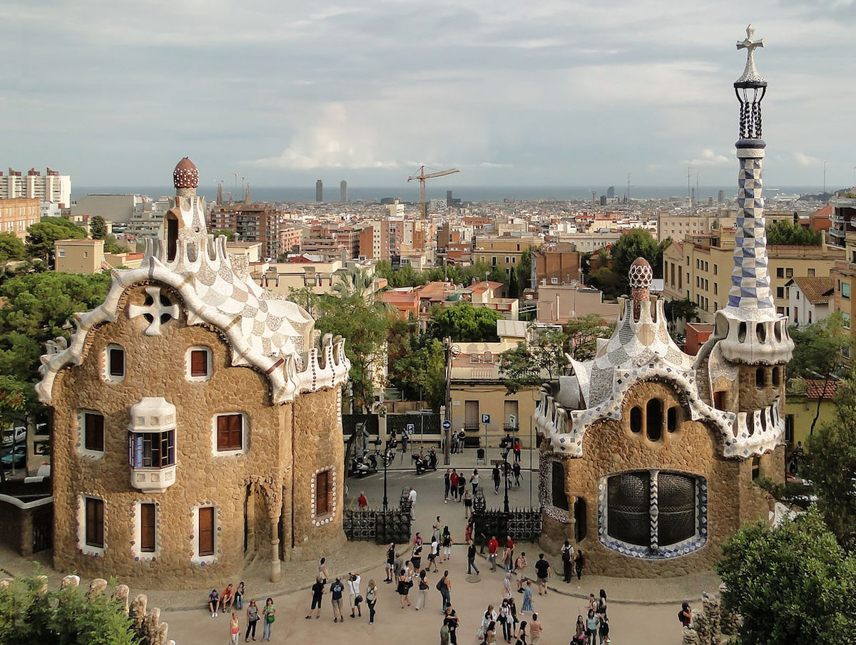 view of Park Güell where people are seen walking around and appreciating the architecture