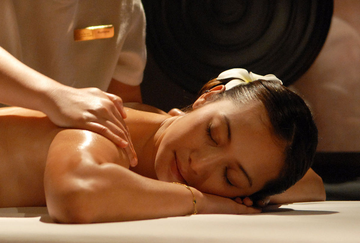 a happy woman having a relaxing Thai massage