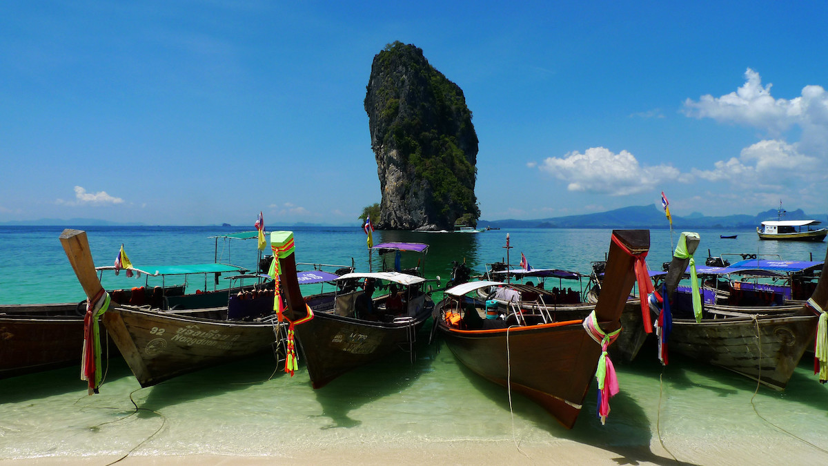 boats are in line ready to go island hopping from Ao Nang beach, Thailand