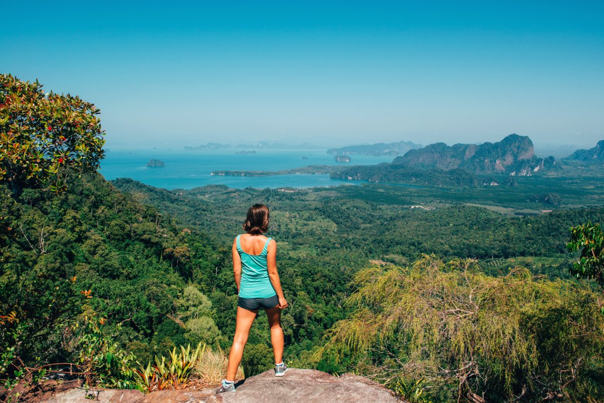 Girl standing on the view poinf of the mountain, Tab Kak Hang Nak Nature Trail, Thailand