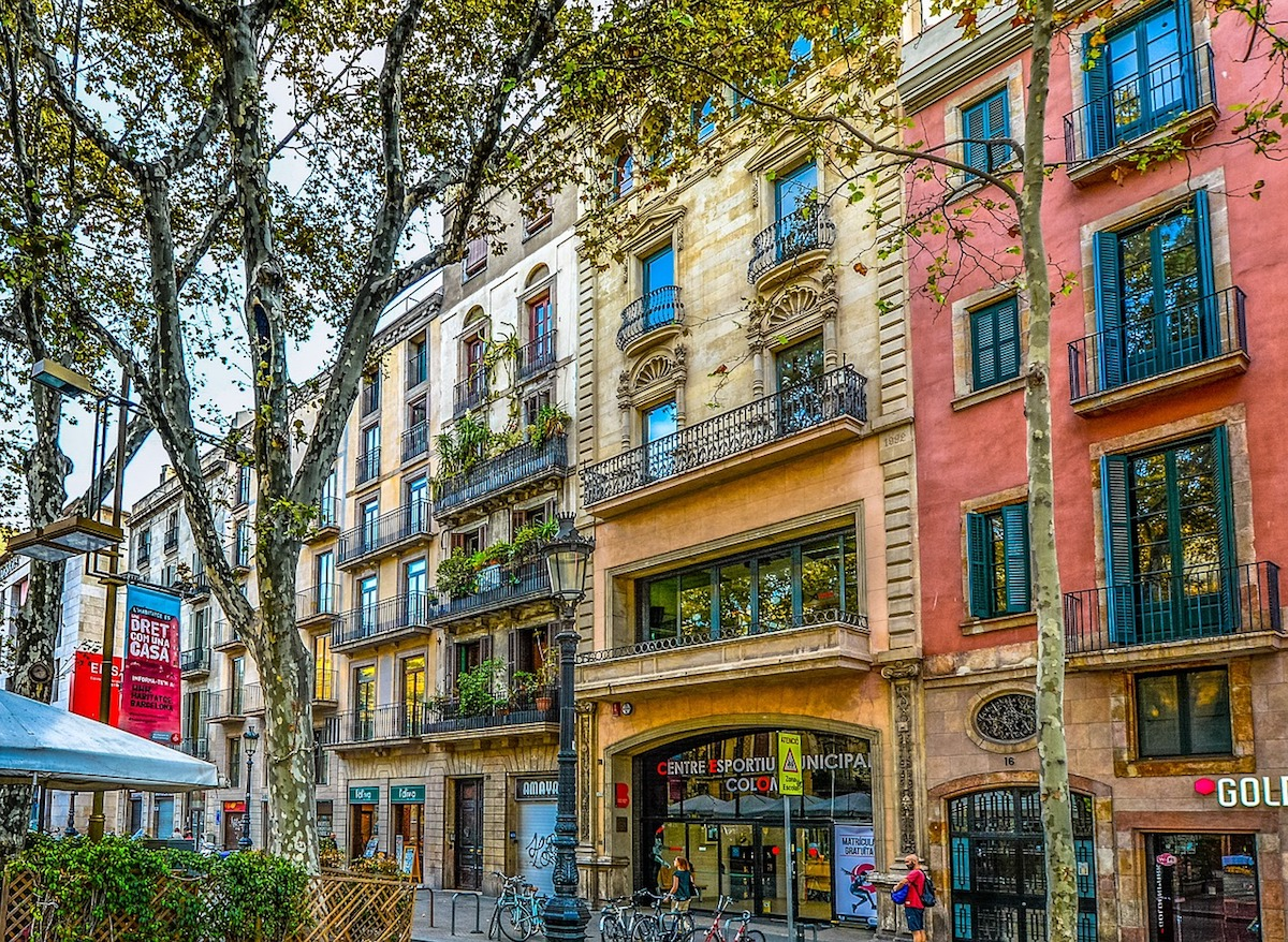 colorful residential buildings line the street in Barcelona