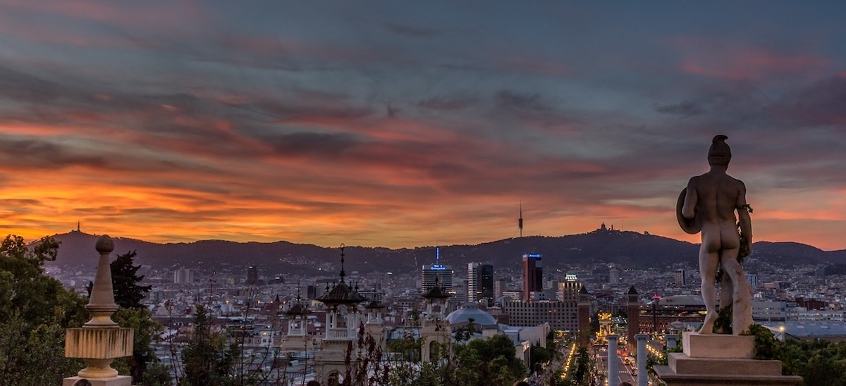 view of the city of Montjuic while the sun sets