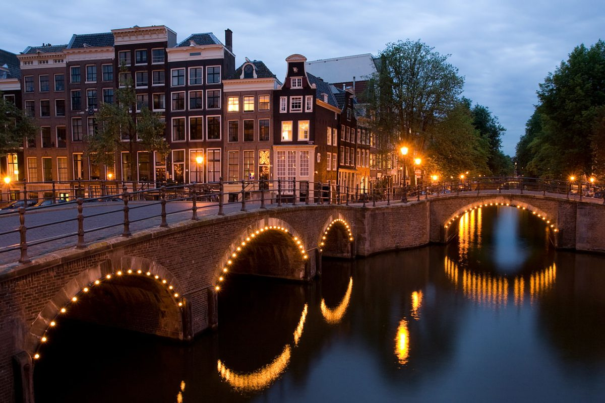 Nighttime photo of Amsterdam's canals with beautiful fairy lights