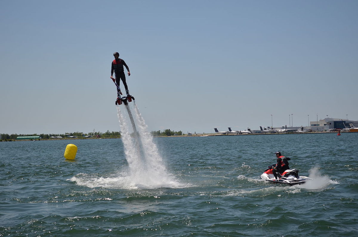 a man trying out flyboarding