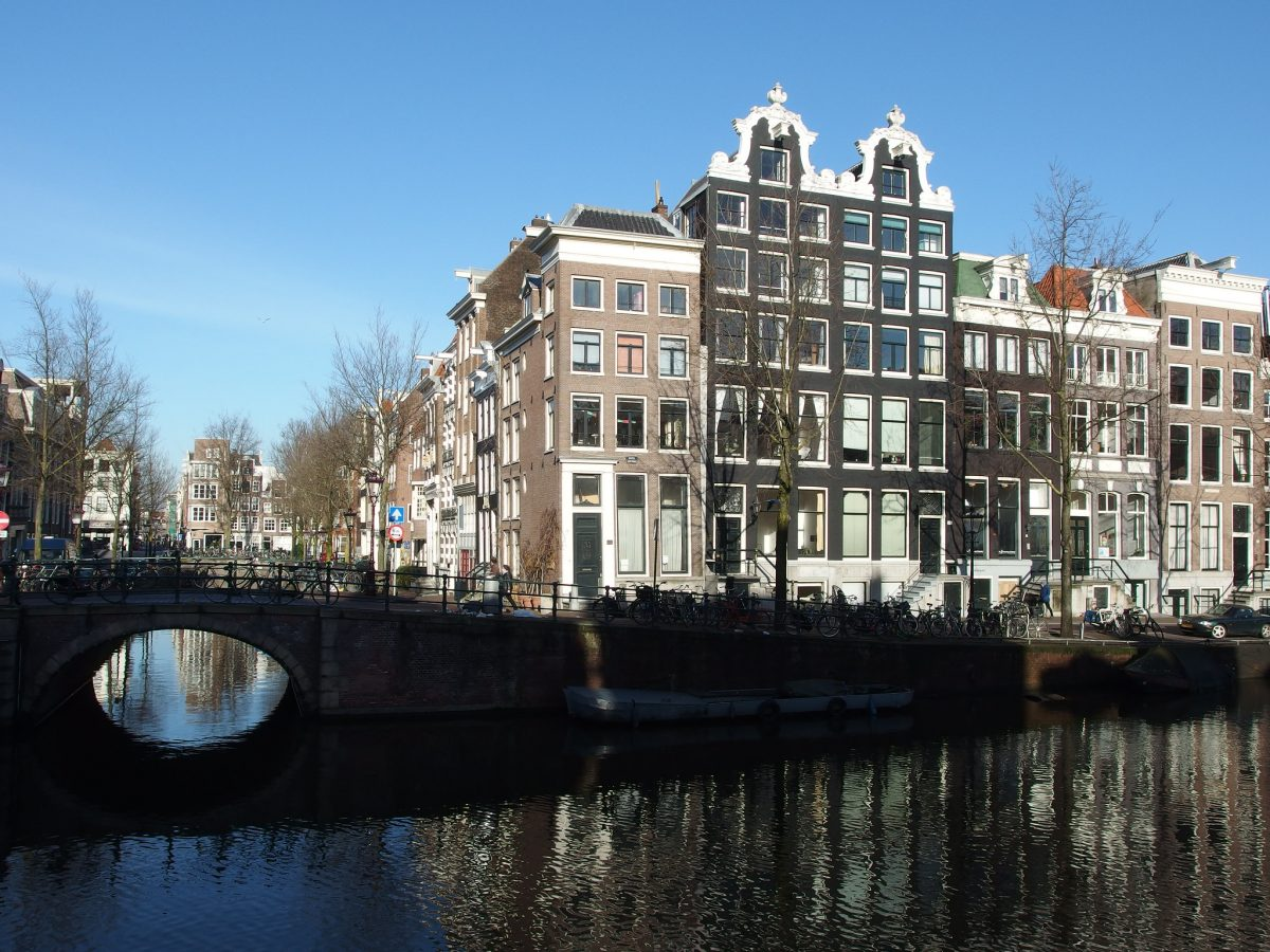 Scenic view of Amsterdam's Jordaan with the bridge hiding under the shadows