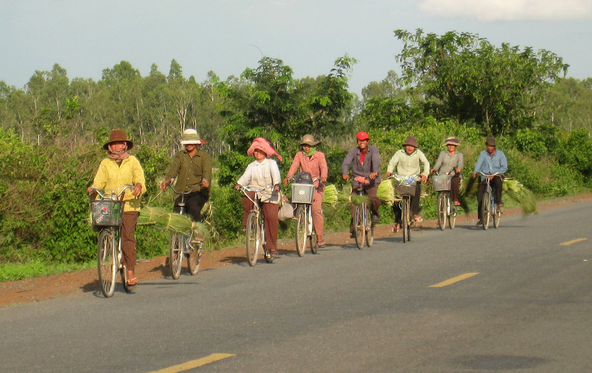 a group of Thais cycling on the side of the road