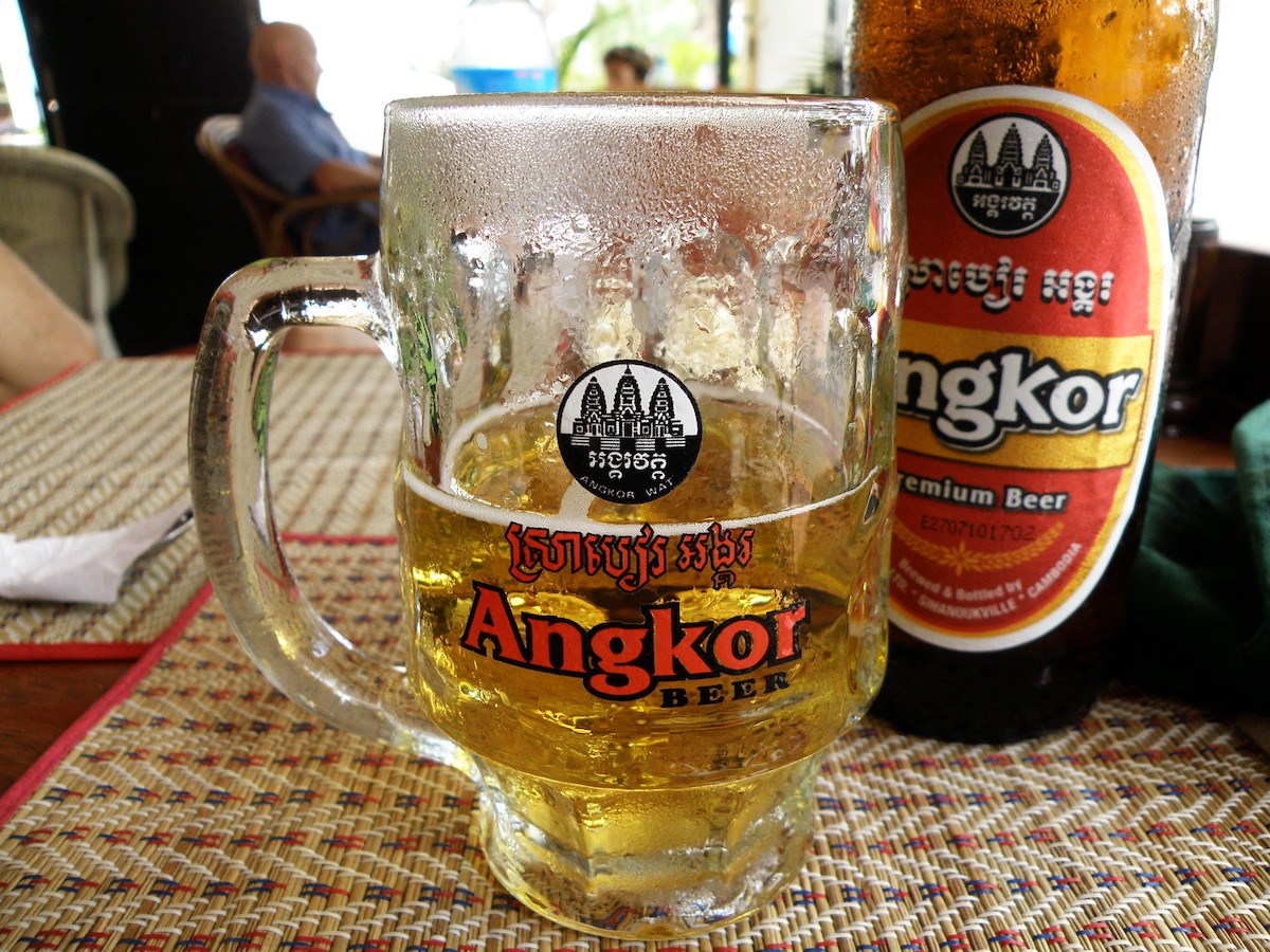 a glass of cold Angkor beer