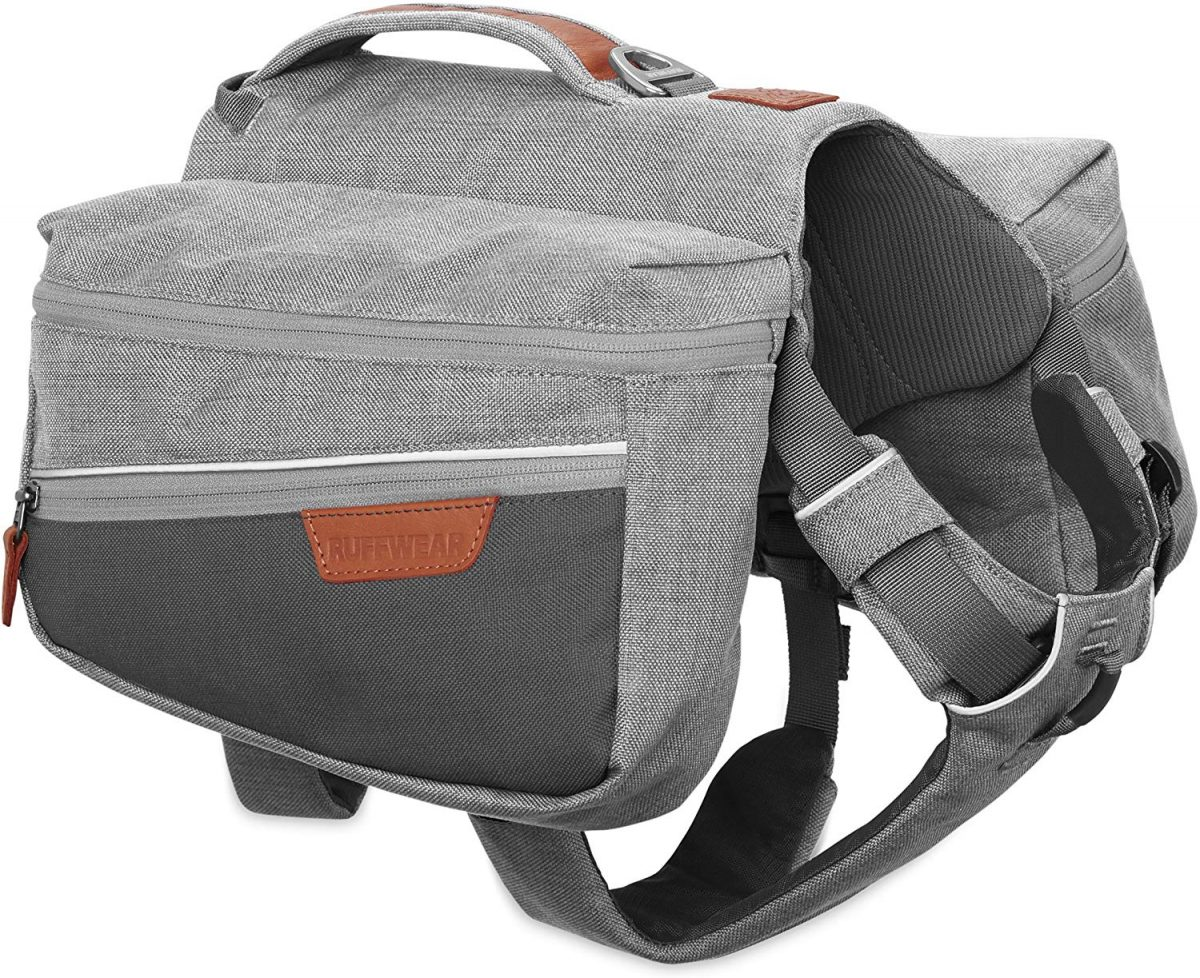 Photo of the grey saddle bag dog backpack with brown accents and a white background