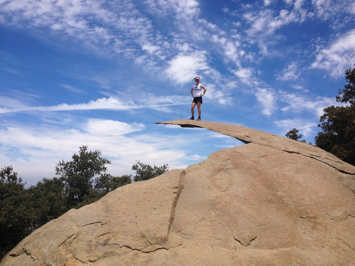 Hiker on top of Potato Chip Rock, San Diego