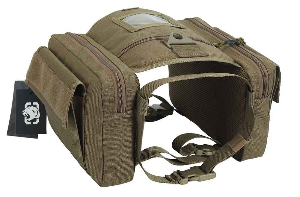 Photo of the brown saddlebag with compartments on either side connected by a padding on top with straps on the bottom and tags to the left side of the bag