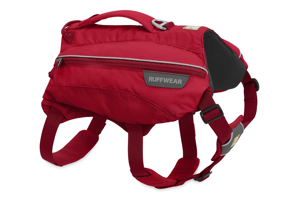 Photo of the red Singletrak Pack in its side view with a dark grey interior and straps along the bottom with a handle on top