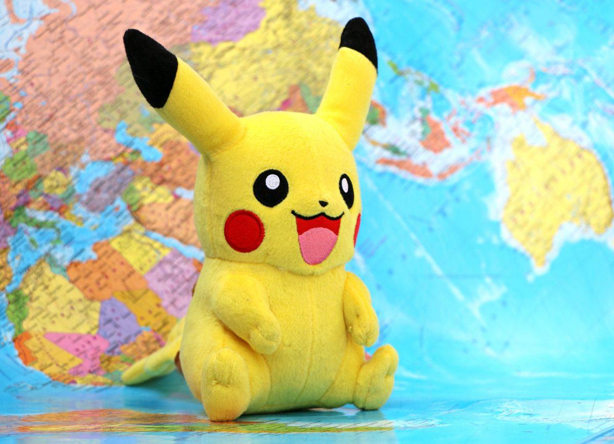 Pikachu pokemon behind the a globe