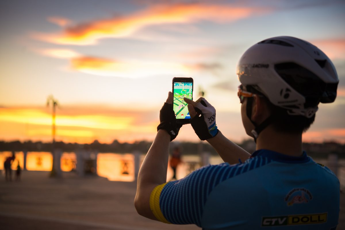 Pokémon hunting on a bike during sunset