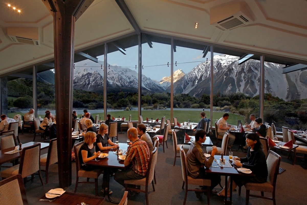 Guests dine at The Hermitage Hotel's Alpine Restaurant which showcases a spectacular view of Mount Cook National Park in New Zealand