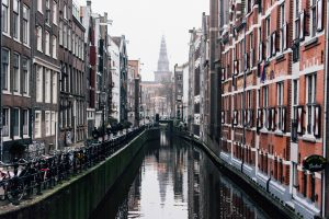 Long shot photo of Amsterdam's canals, with beautiful background buildings