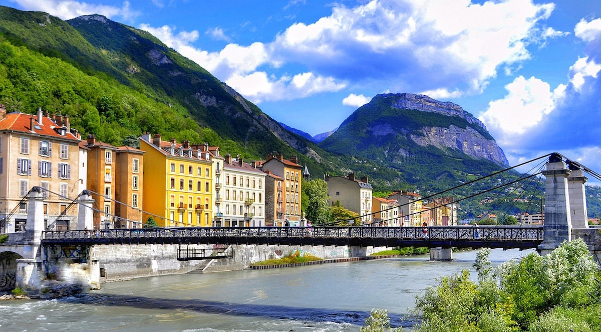 The famous bridges in Grenoble City surrounded with lush green French Alps