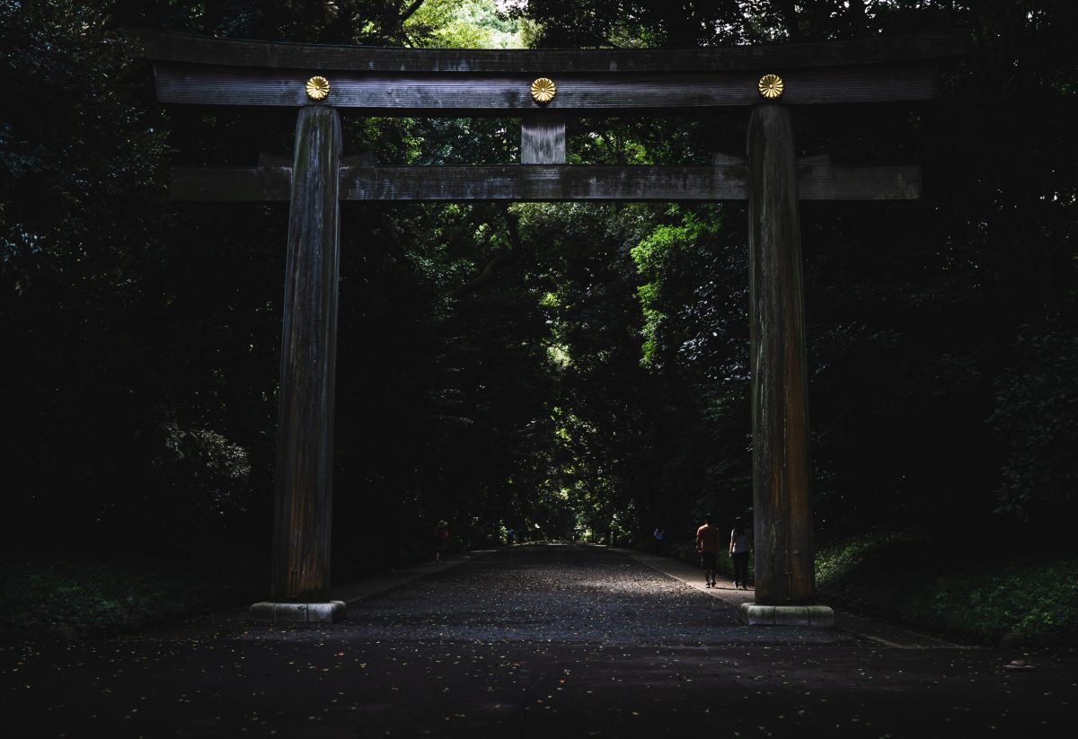 The wooden torii gate that greets visitors at Meiji Shrine, Tokyo, Japan
