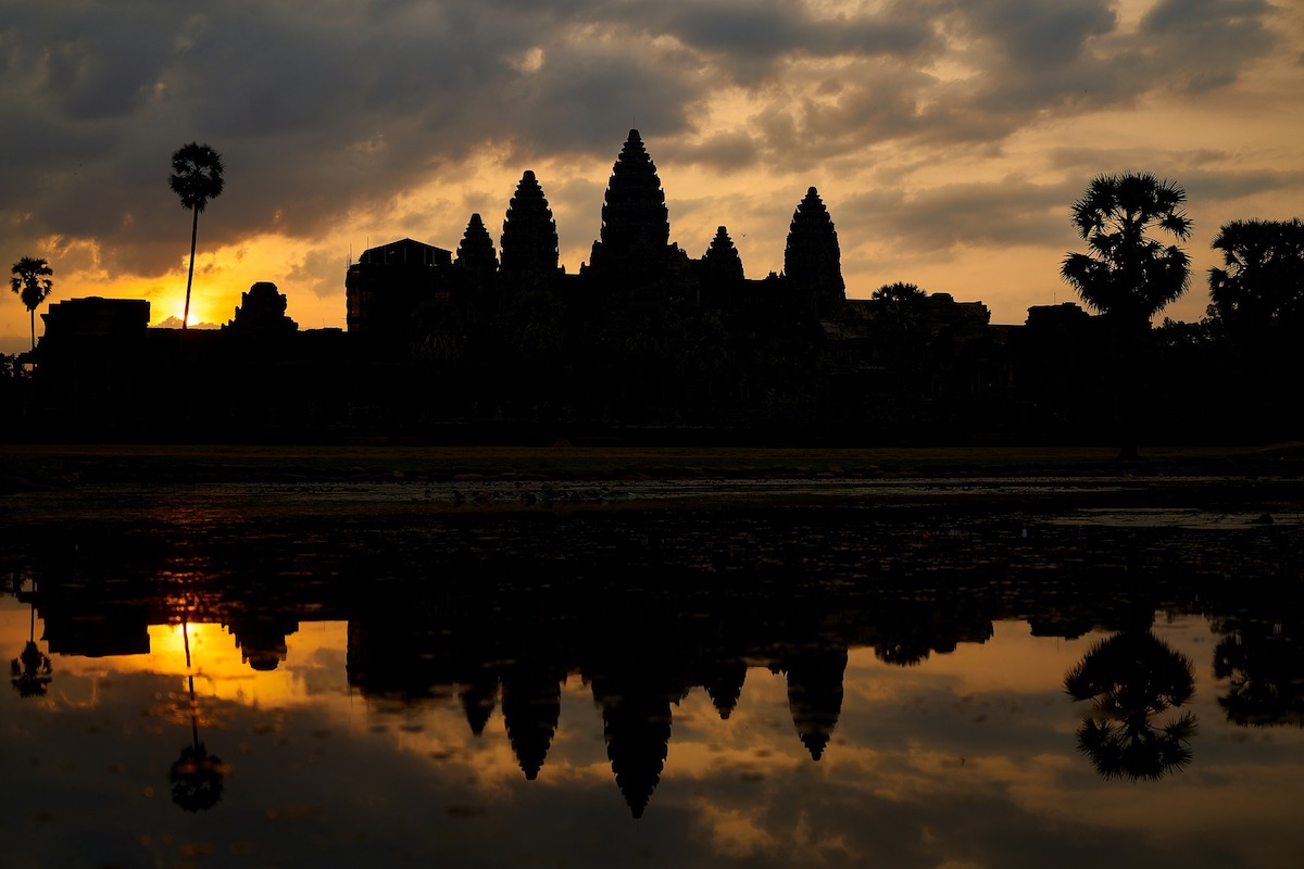 captivating photo of Angkor Wat with the sun rising at the background